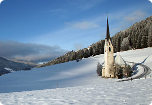 Church in the snowscape of the Dolomites