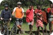 Cyclists and Masai, near Wasso, close to Serengeti