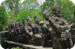 Cambodia the doors of Angkor Thom: View of the  impressive stone seated guardians of the city