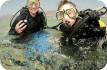 Mum and son scuba diving in the Red Sea