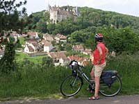 Cyclist and Chateau de Rochepot