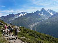 Walkers on Grand Balcon path, looking towards Mont Blanc