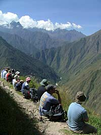 The group stops to rest and enjoy the scenery on the Inca Trail