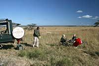 Family at bush breakfast, Masai Mara