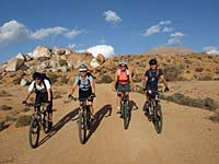 Group riding near the Blue Rocks, Tafraoute