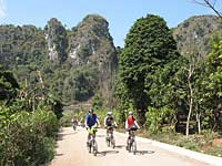 Cyclists and limestone karst mountains, Viengsai