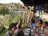 Bikers eating lunch next to bombs, Plain of Jars, Phonsavanh