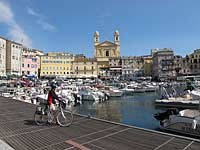 Cyclist and Bastia old harbour