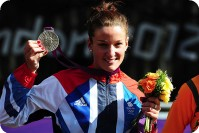 Silver medallist Elizabeth Armitstead of Great Britain celebrates during the Victory Ceremony after the Women's Road Race Road Cycling on day two of the London 2012 Olympic Games