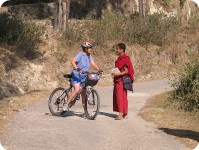 Cyclist and monk, near Tibetan Buddhist Monastery, Bir, Kangra Valley