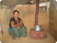 Lady next to her smokeless stove, Nalbung, Nepal