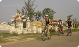 Cycling past tombs, near Hue