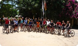 Cycling group on beach at end of trip, Sri Lanka