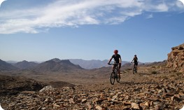 Bikers riding rocky track in Anti Atlas