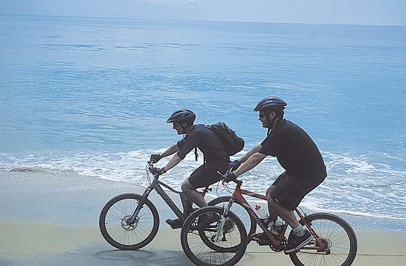 Cycling on the beach at Kerala, India