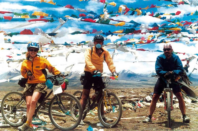 Cyclists and Prayer Flags in Tibet