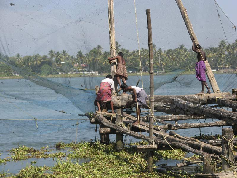 Locals working chinese fishing net, Cochin