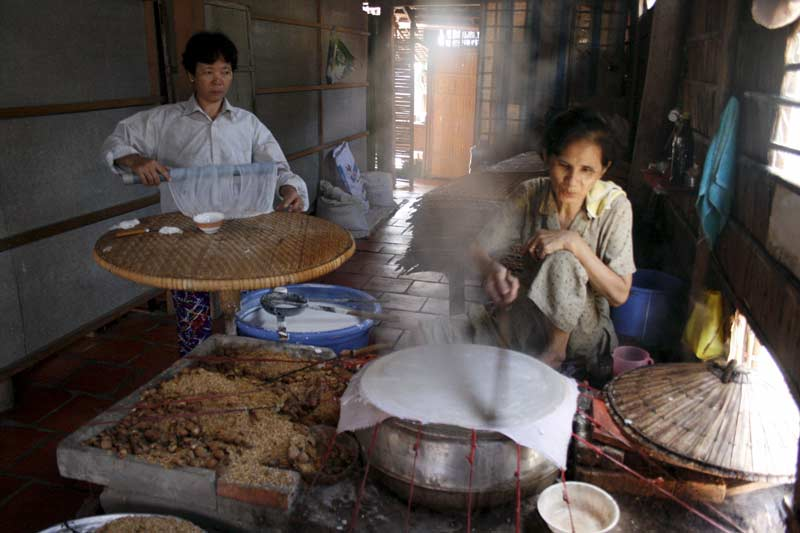 Rice paper makers in the Mekong delta, Vietnam