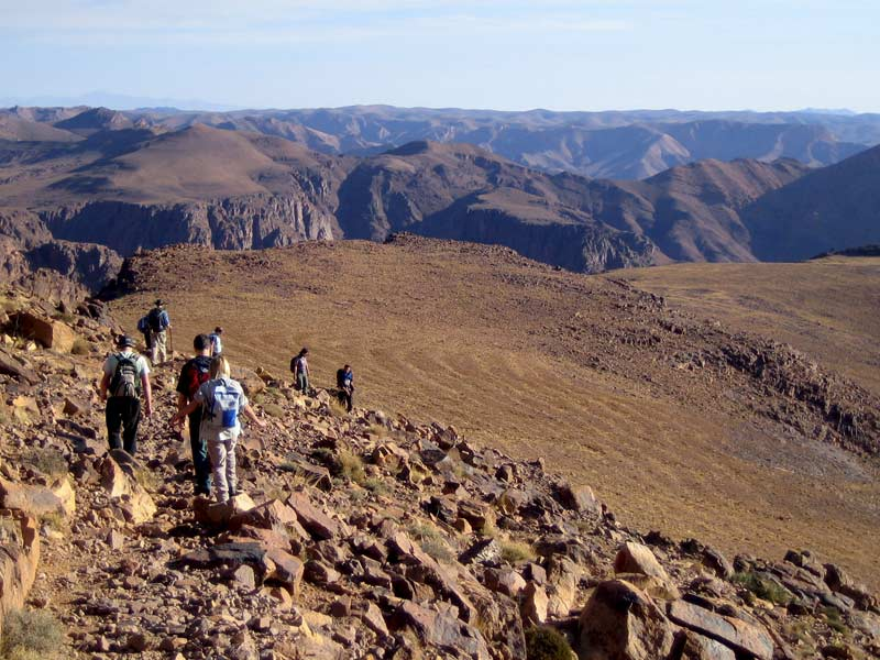 Group walking through rugged country, Anti Atlas