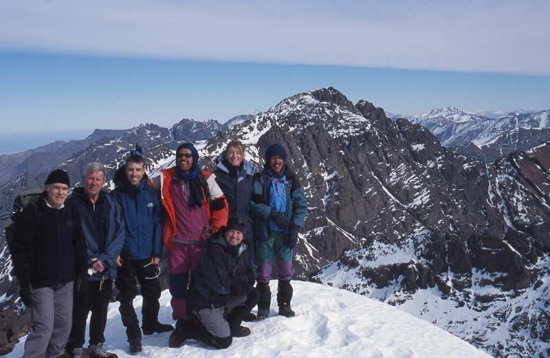 Trekkers on summit of Toubkal in winter
