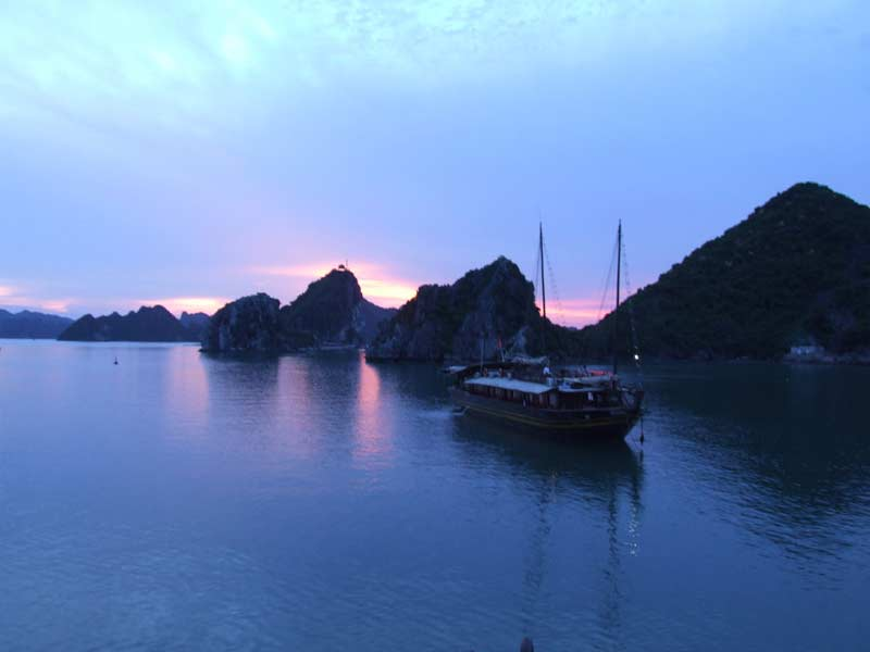 Boat in Halong Bay at sunset