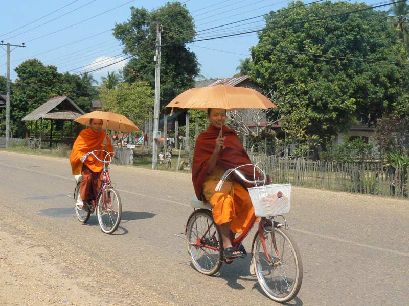 Monks cycling in Luang Prabang