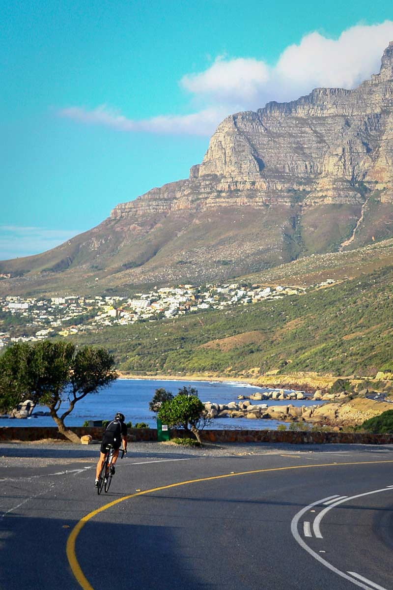 Cycling under Table Mountain.