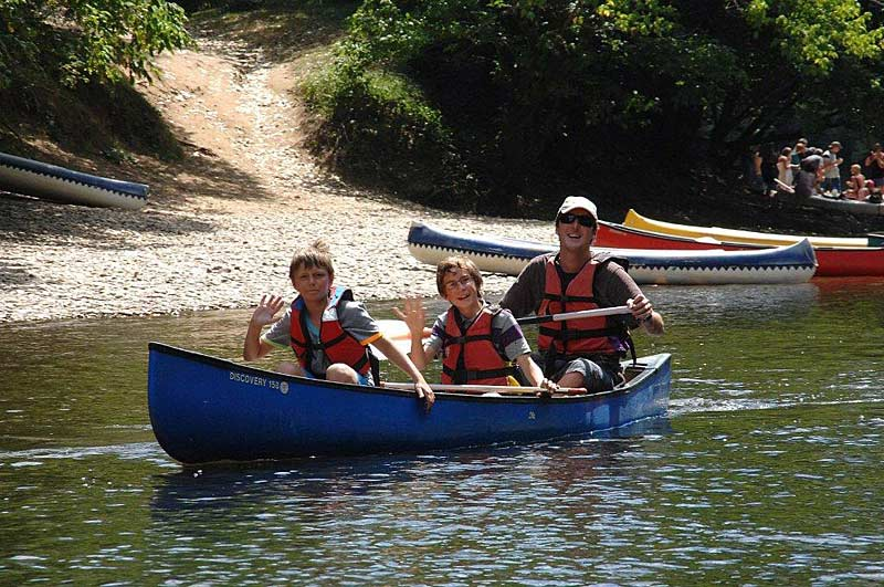 Family canoeing on the Dordogne River