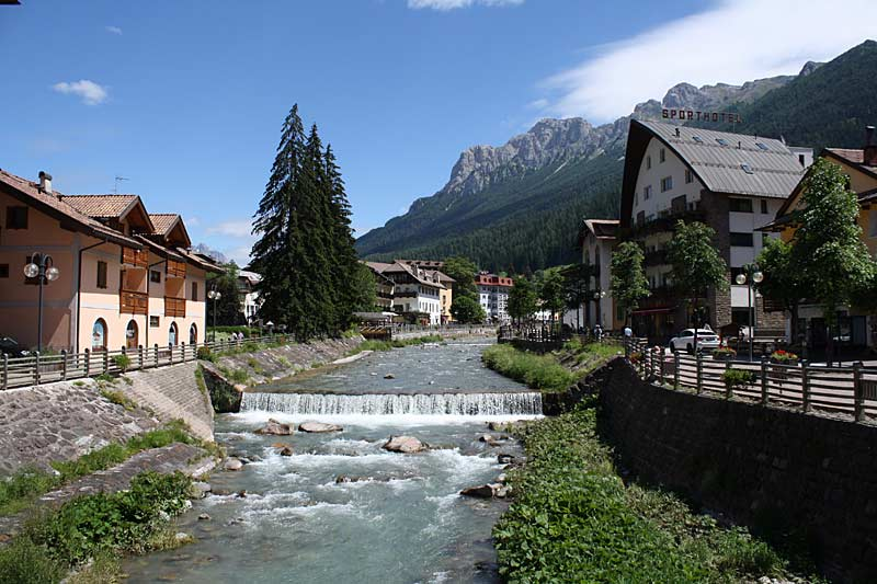 Stream running through village of the Dolomites