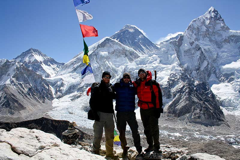Group summit of Kala Pattar (5545m). Mt Everest in the background. Everest Basecamp Trek.