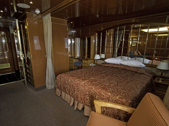 Suite, Deck 6, note the privacy curtain and the dressing table